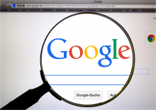 Magnifying glass over the Google logo